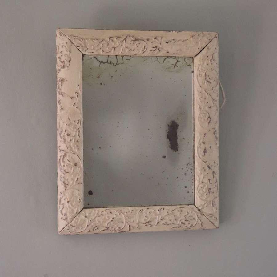 Small cream framed foxed mirror