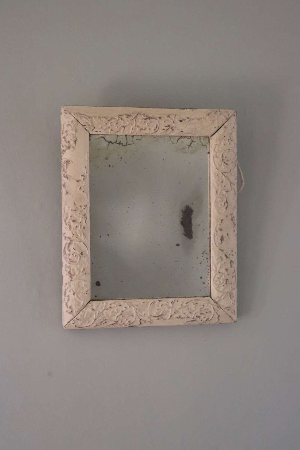 Small cream framed foxed mirror
