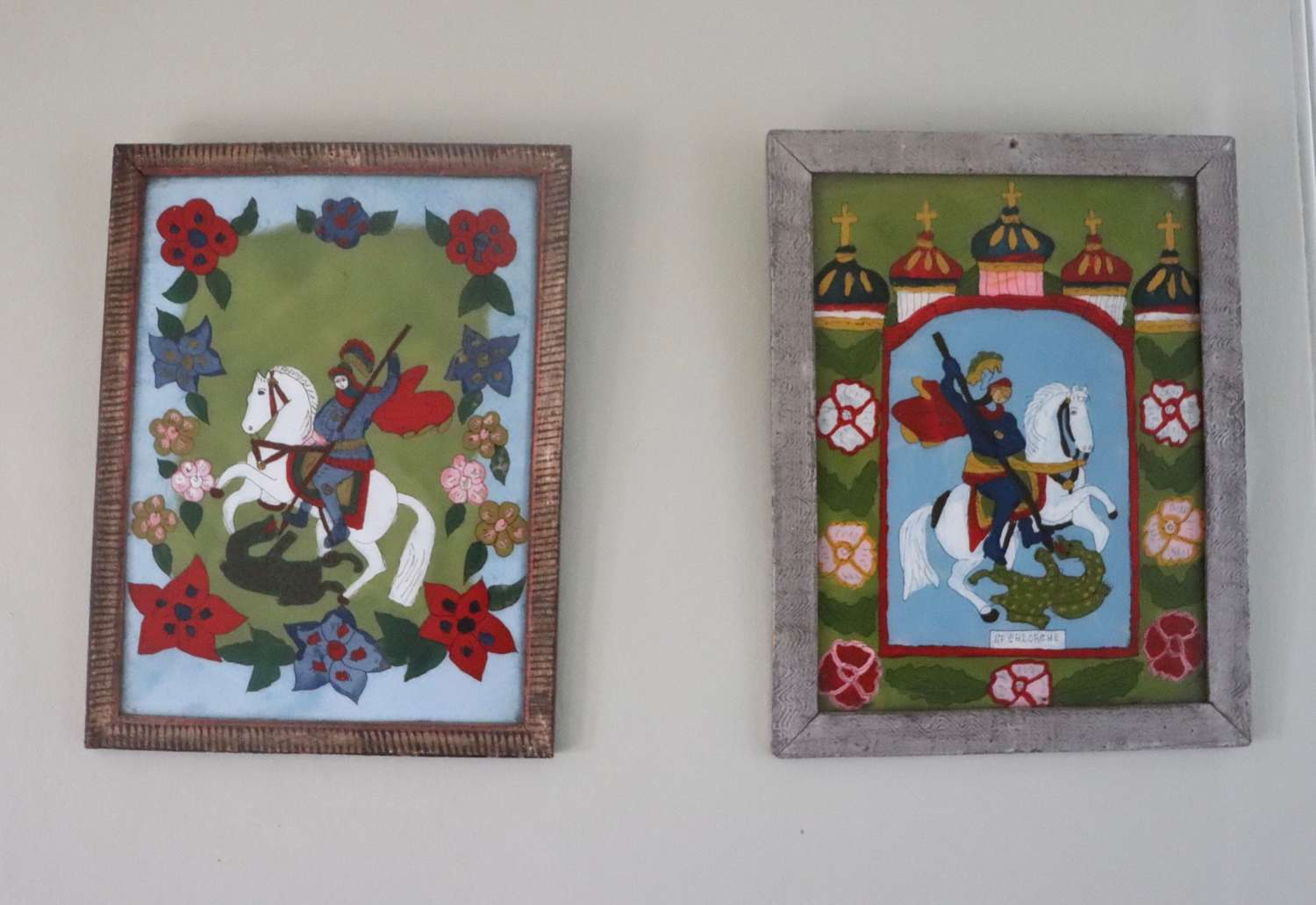 Pair of reverse painted pictures on glass