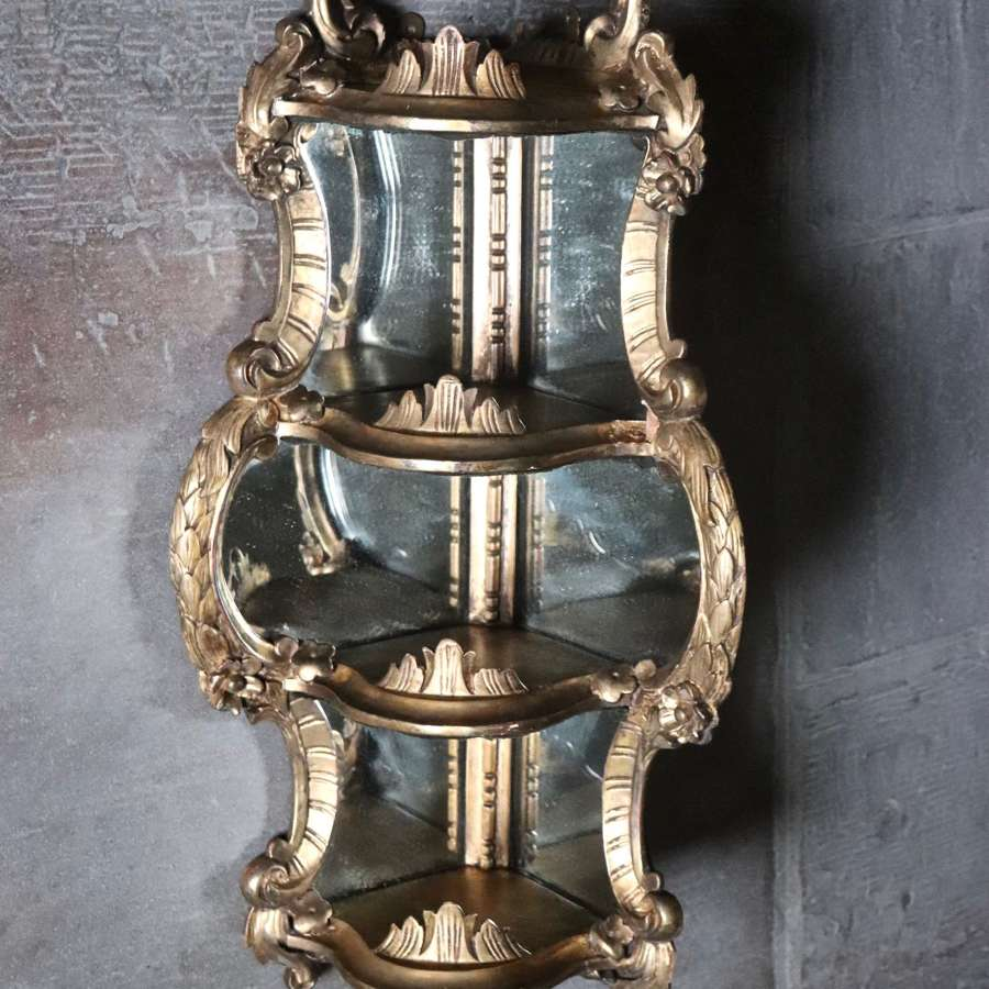 Early 20th century gilt mirrored corner shelves