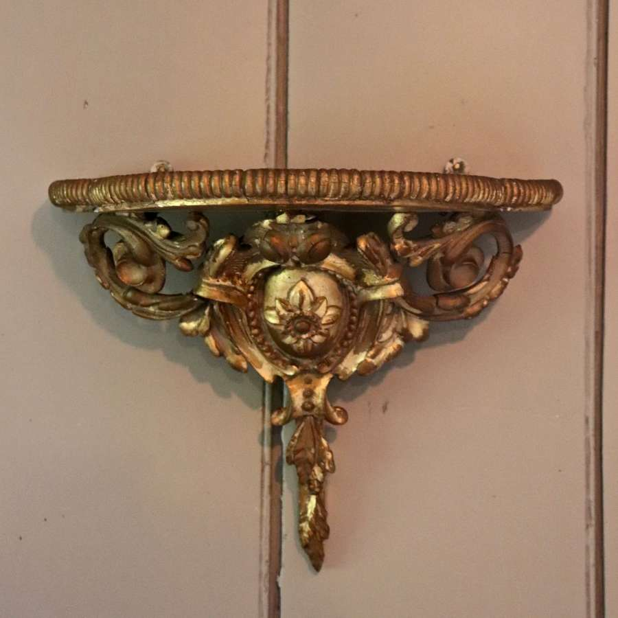 Giltwood wall bracket with velvet top
