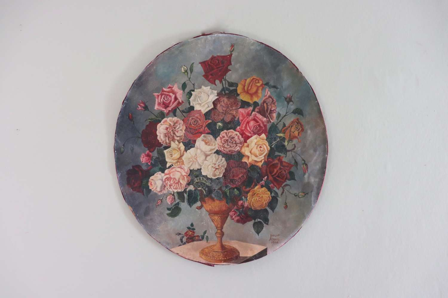 Signed oval oil painting of flowers in an urn