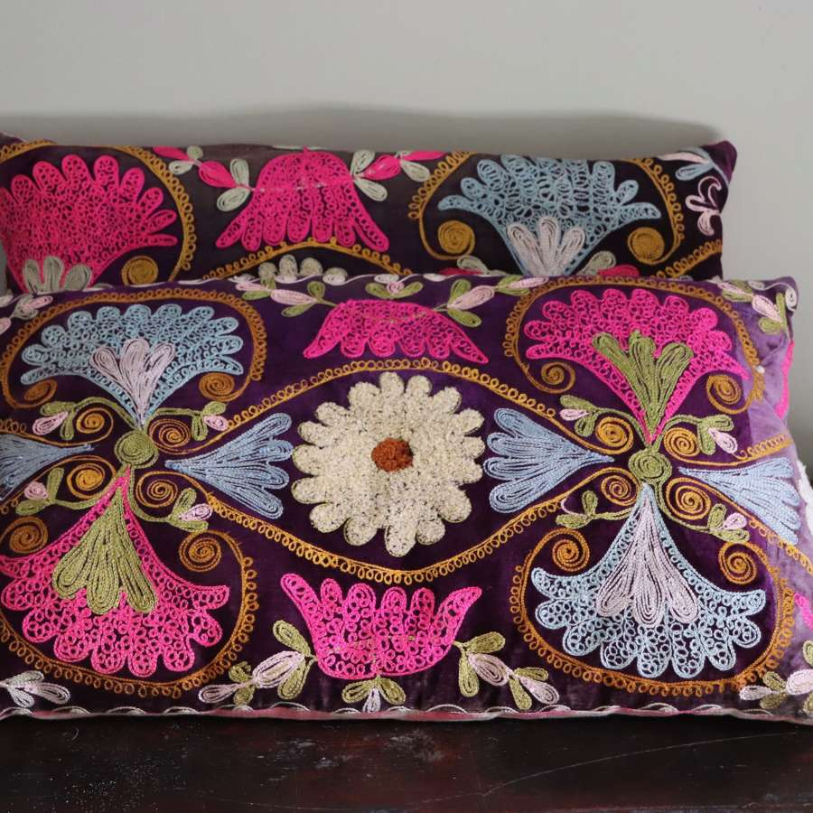 Pair of suzani cushions with silk ikat backs