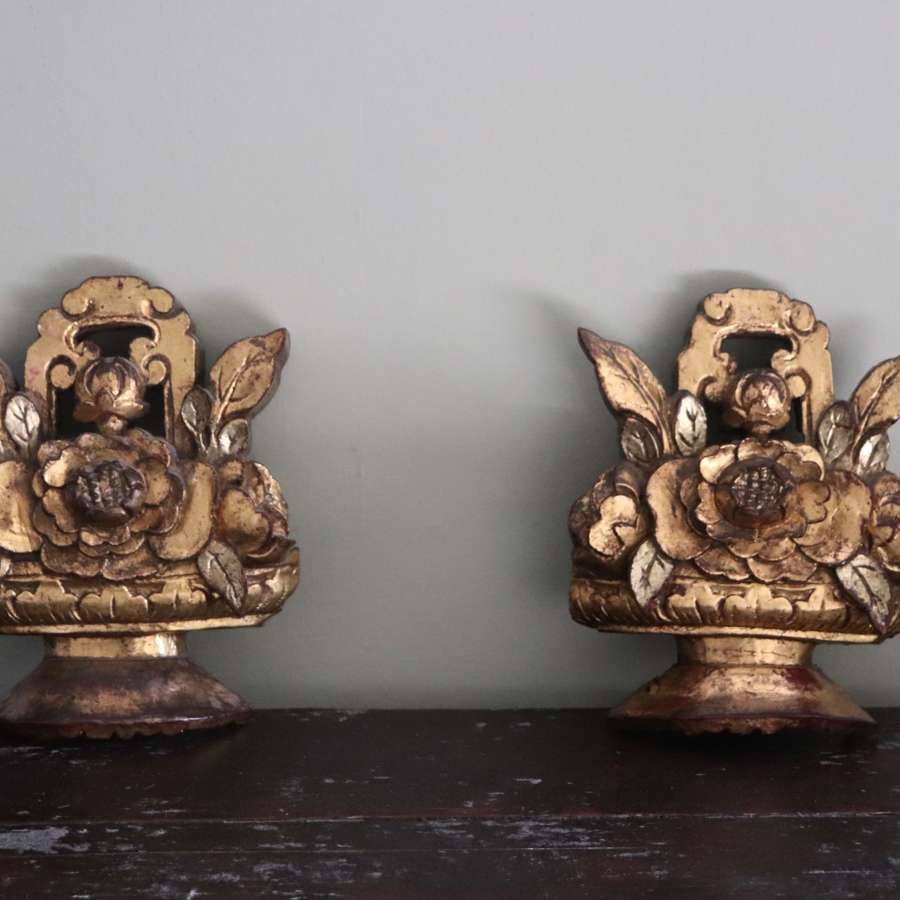Pair of 19th century gilt wooden carvings depicting flowers in an urn