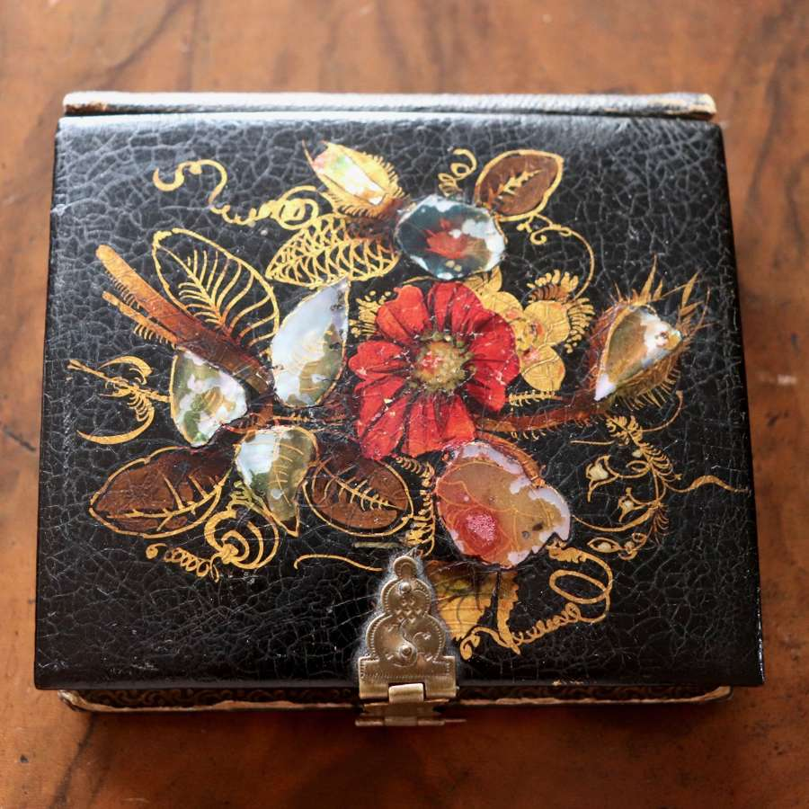 Mother of pearl inlaid wooden box in shape of book
