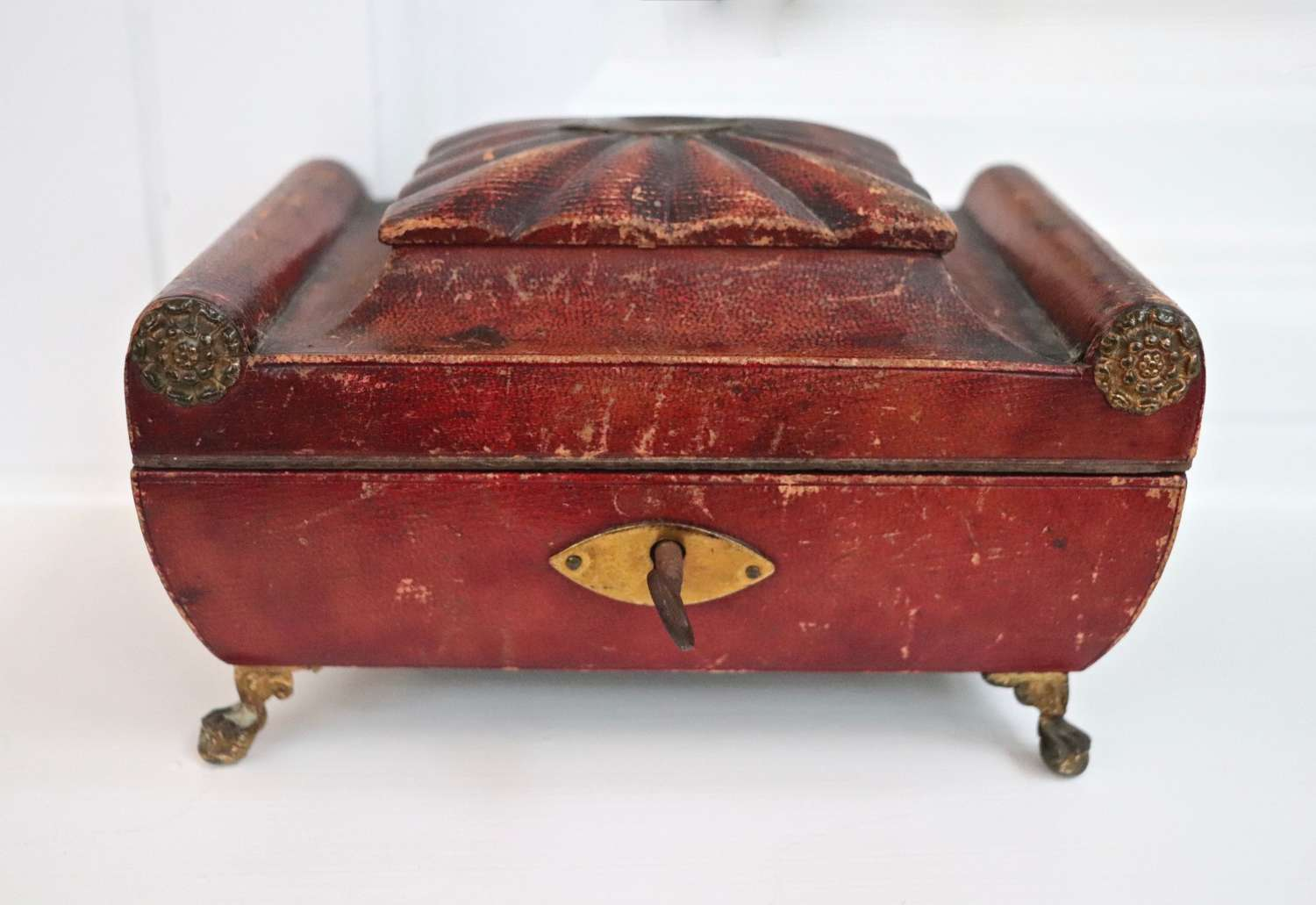 Regency leather covered sewing box with brass mounts
