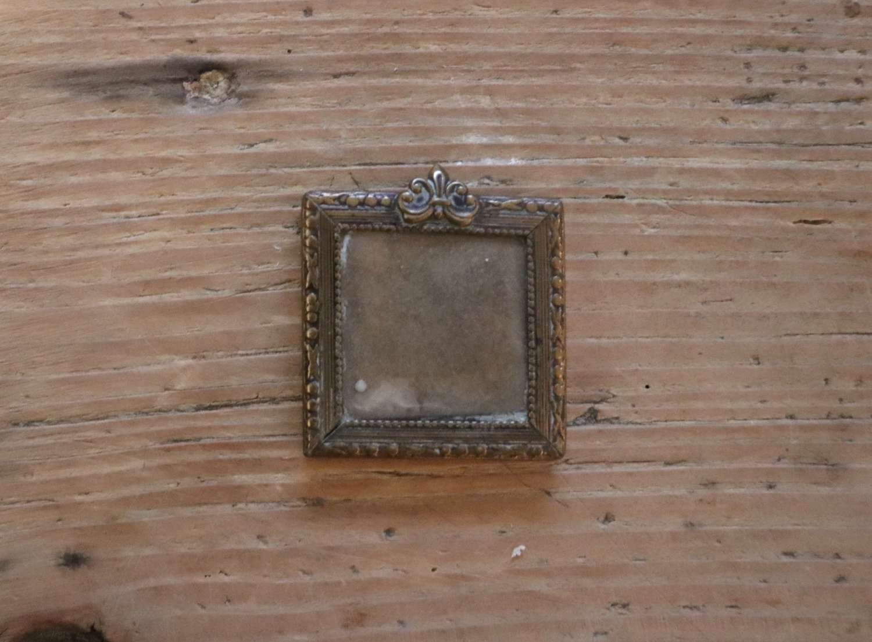 Tiny gilt frame