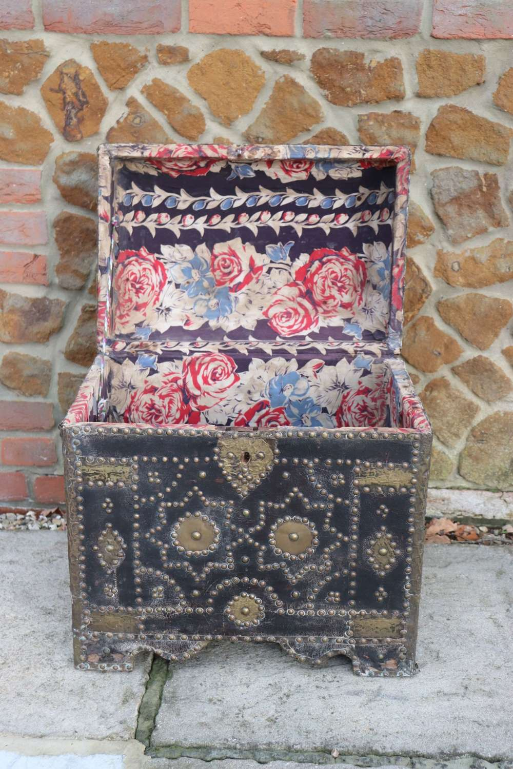 19th century leather box with floral cotton interior and brass studs