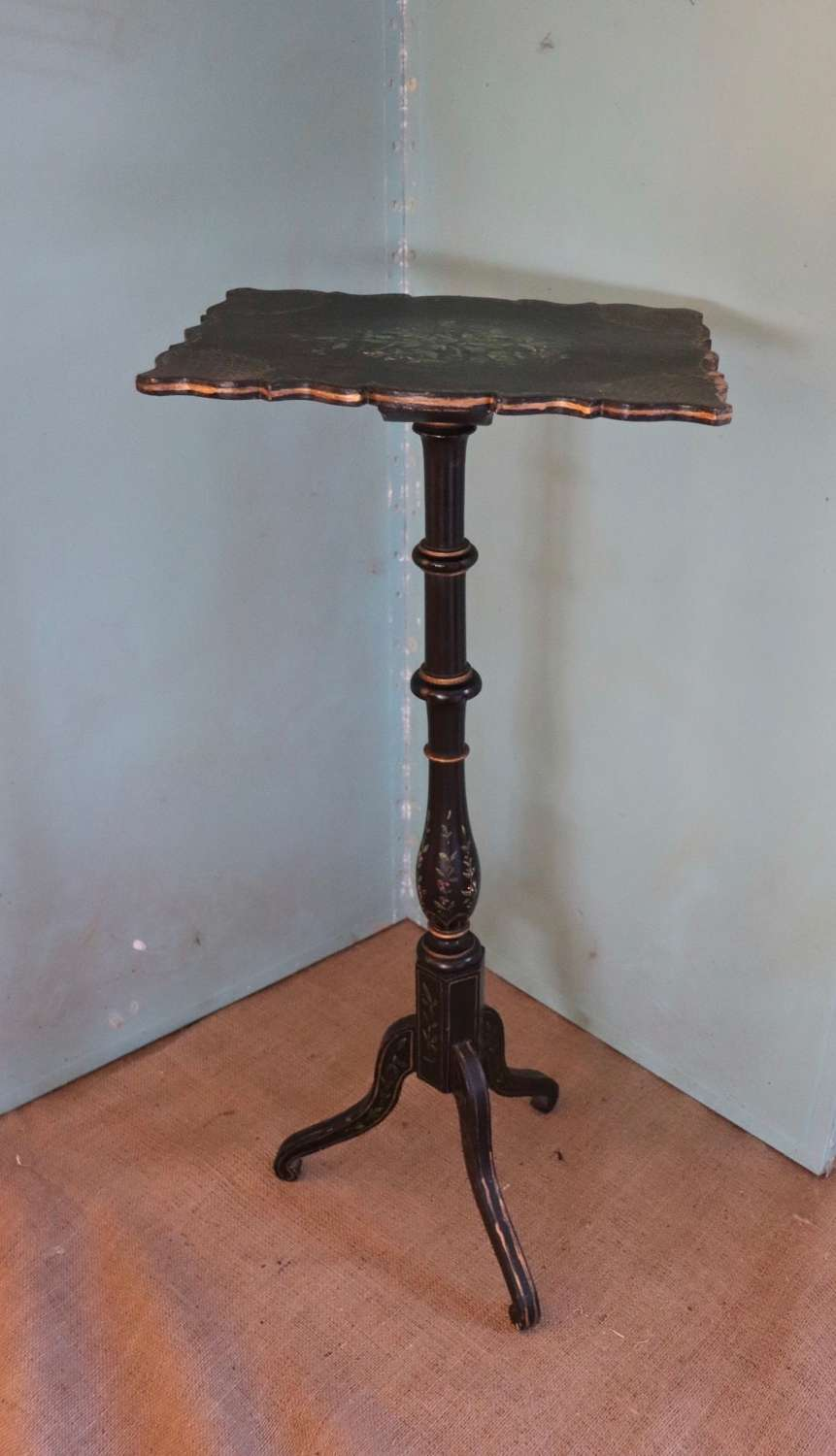 Victorian black tripod table with floral decoration
