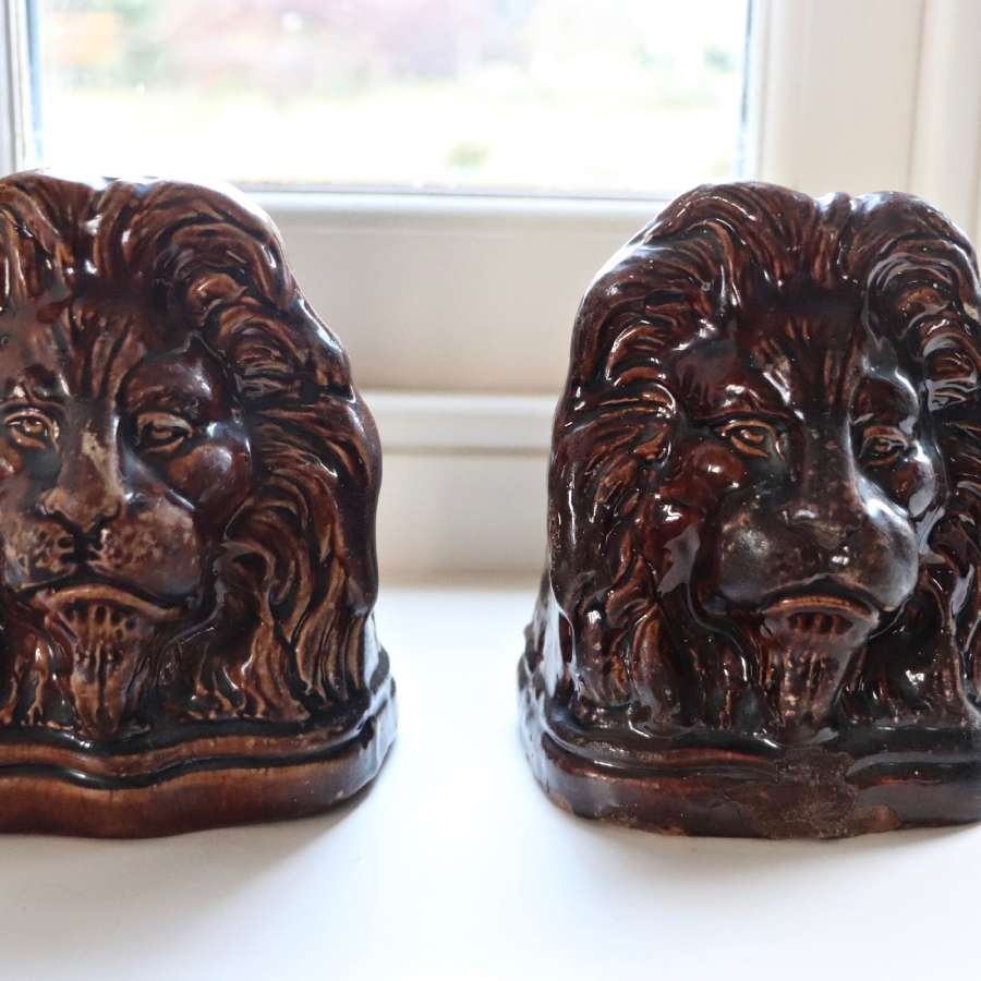 A pair of Victorian sash window stops in the form of lion heads