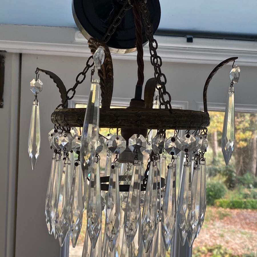 A mid century icicle drop two tier chandelier