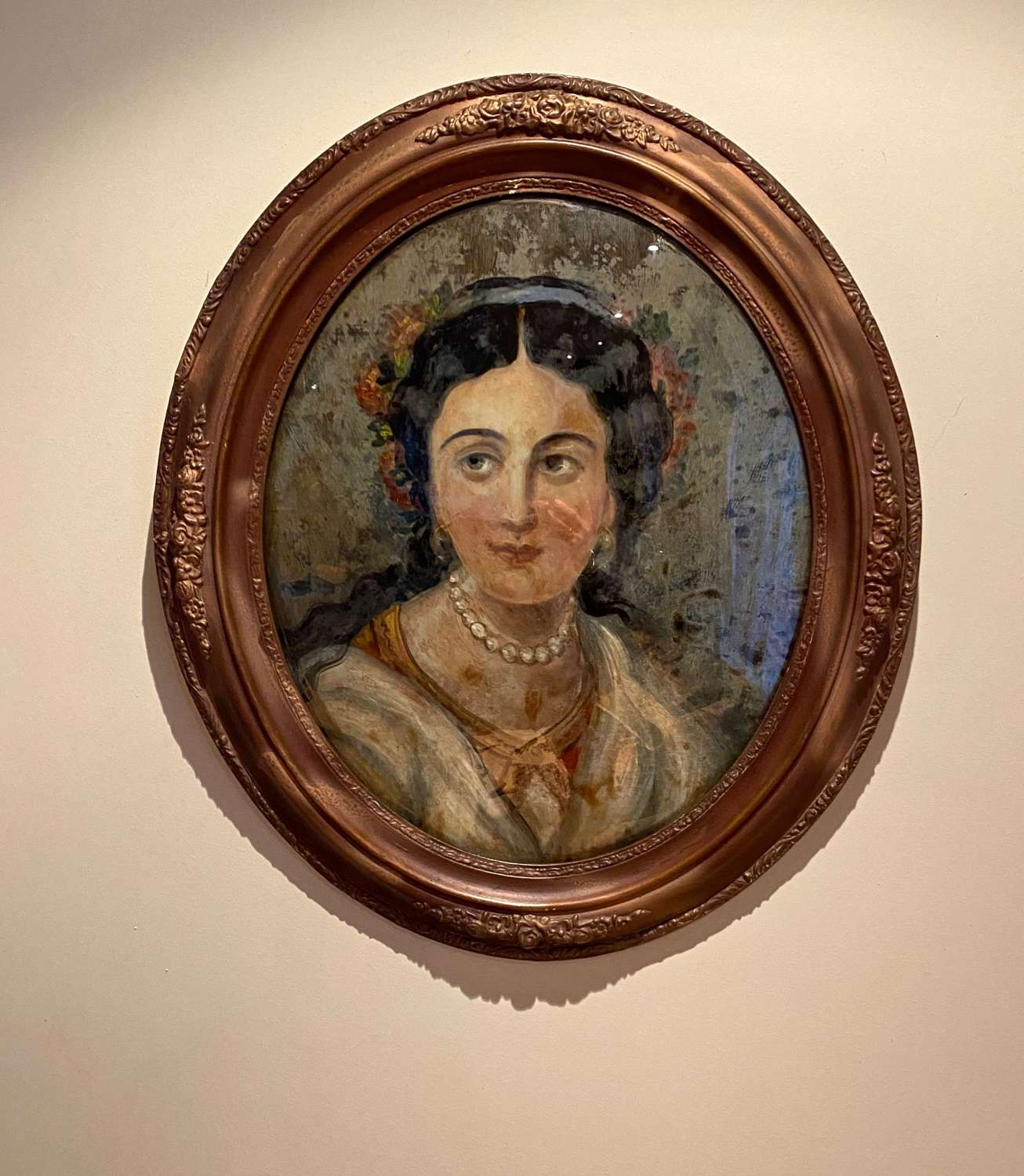 Early 20th century reverse glass painting of lady in oval frame