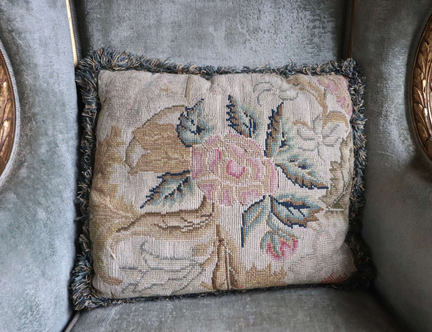 Needlepoint cushion backed in linen