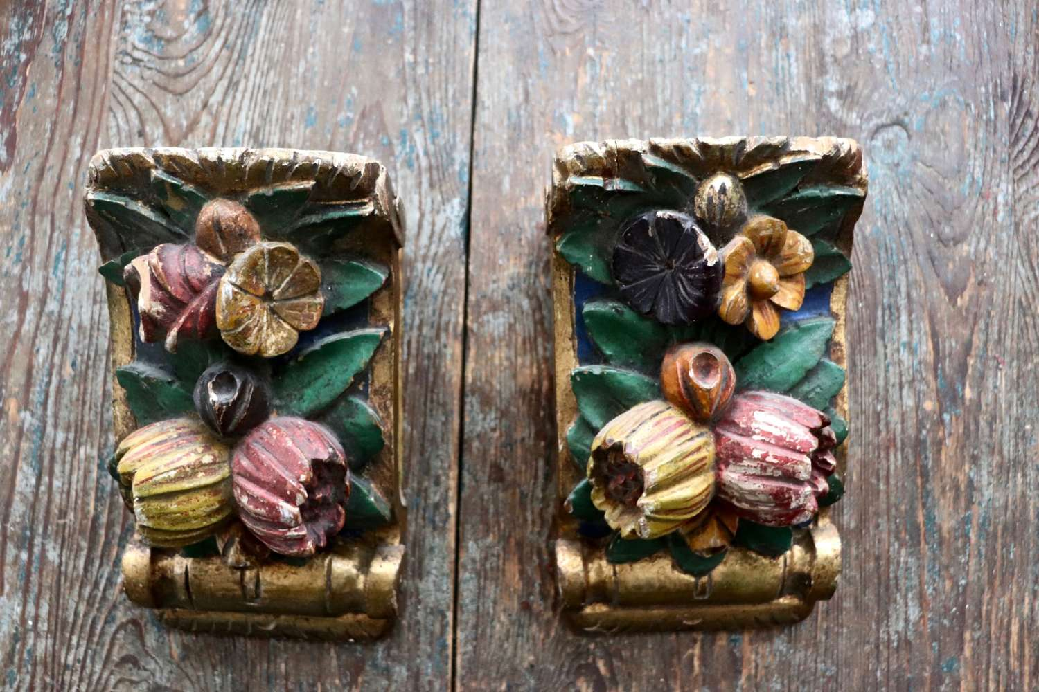 Pair of wooden florally carved gilt and painted wooden brackets