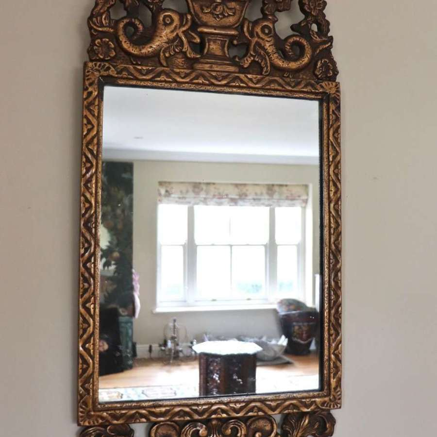 Early 20th century gilt mirror with dolphin carvings