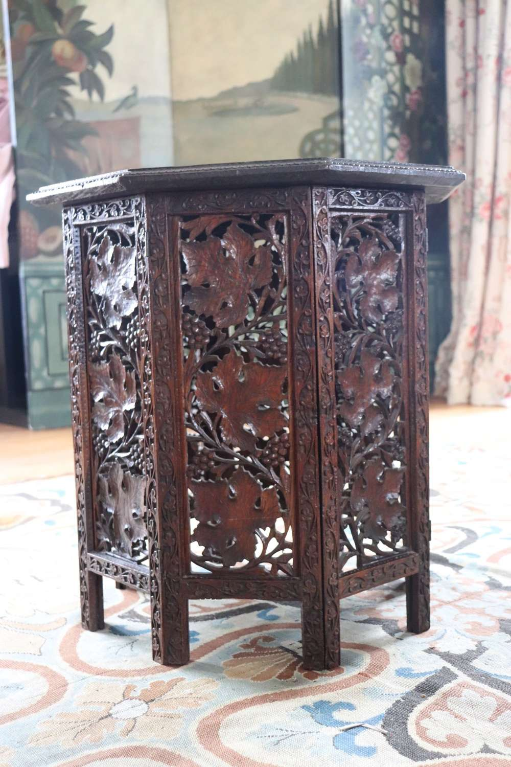 An octagonal Moorish table with carved foliage
