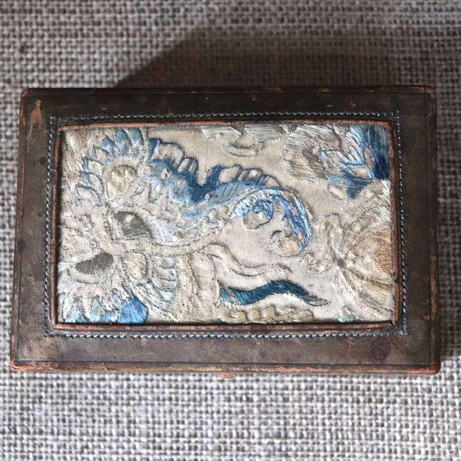 Early 20th century leather box with oriental fabric