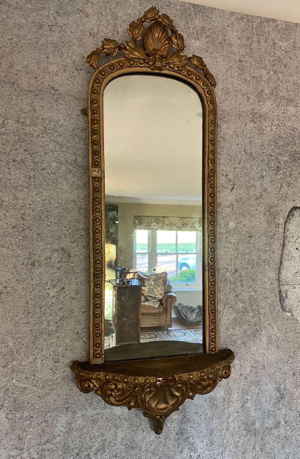 Early to mid 20th century gilt mirror with velvet shelf