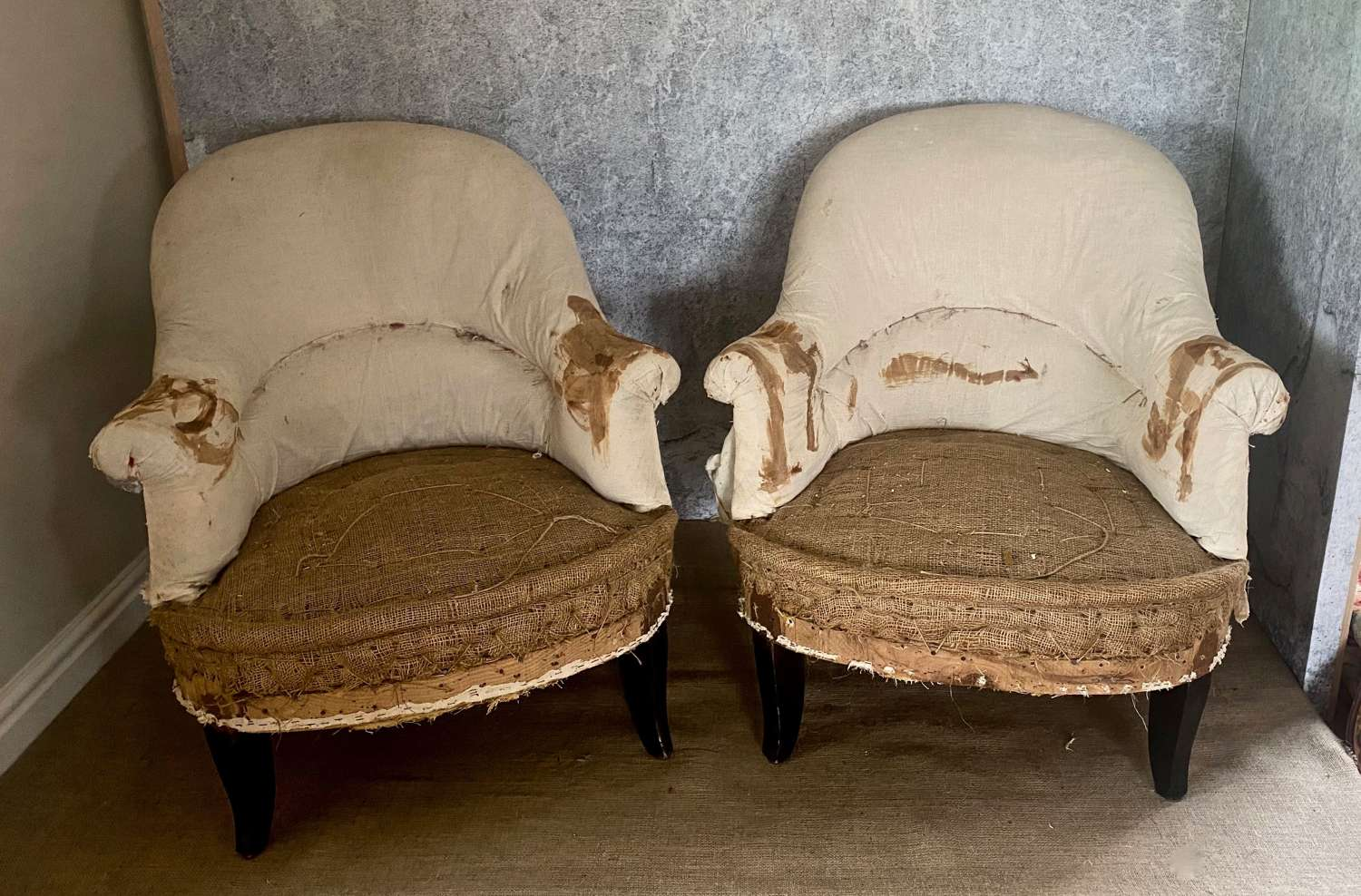 Pair of small deconstructed French armchairs in calico and hessian
