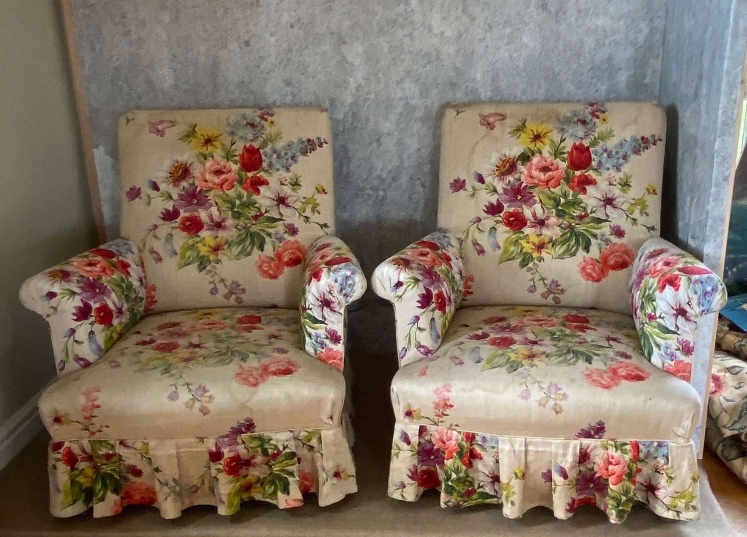 Pair of French armchairs with beautiful faded floral linen