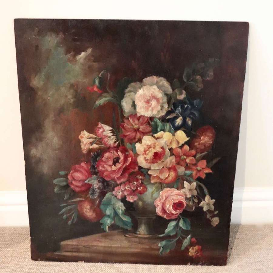 Floral oil on board dating the the late 19th/early 20th century