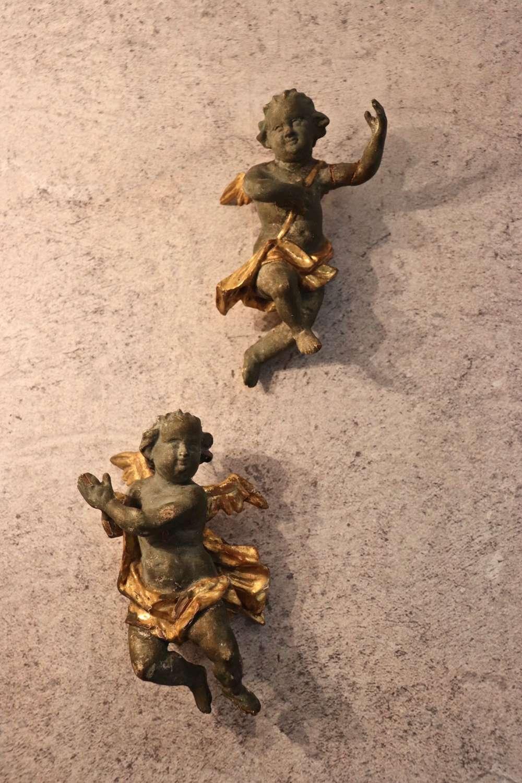19th century carved wooden cherubs