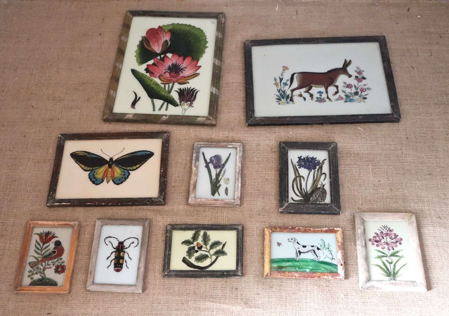 Selection of reverse glass painted Indian pictures