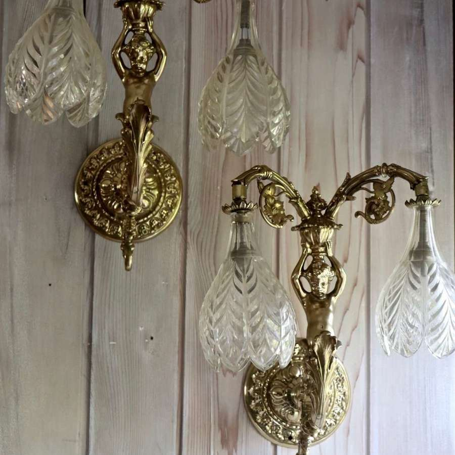 Brass wall sconces with cherubs and cut glass shades